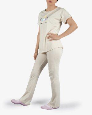 ست تیشرت و شلوار نخی زنانه طرح تک شاخ - استخوانی - روبهرو