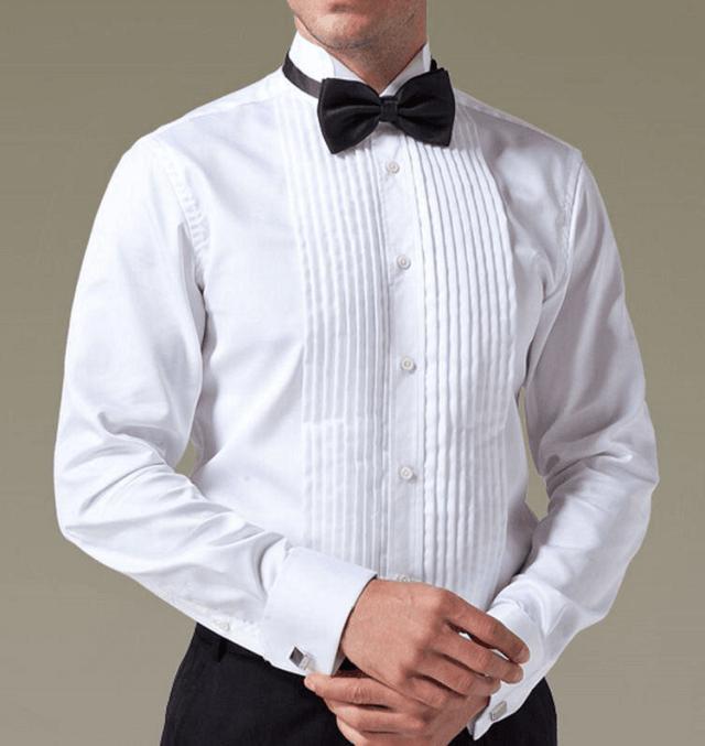 پیراهن رسمی سفید به همراه پاپیون و دکمه سر دست مشکی و شلوار مشکی