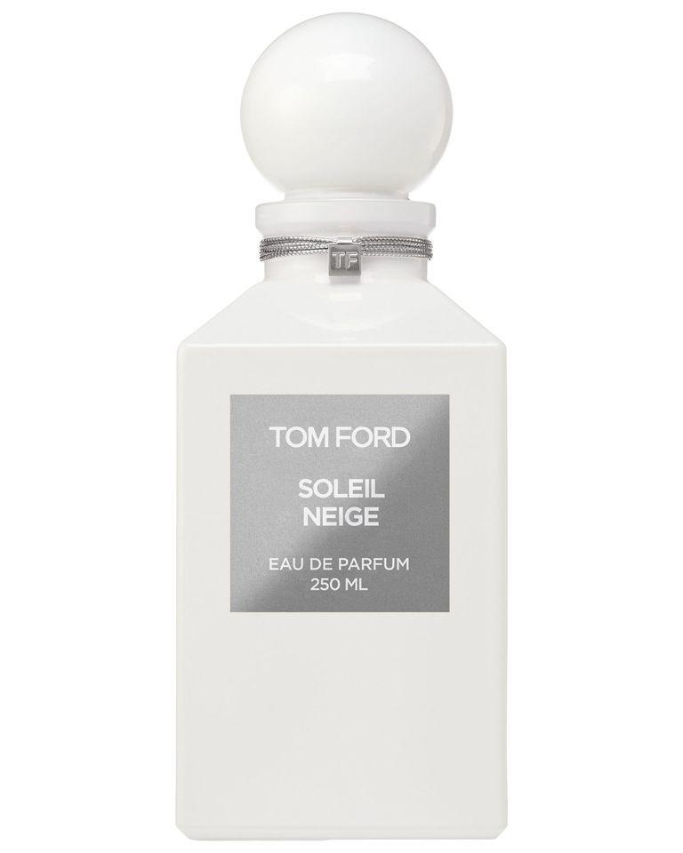 عطر زمستانی تام فورد شیشهی سفید مات و در دایره شکل